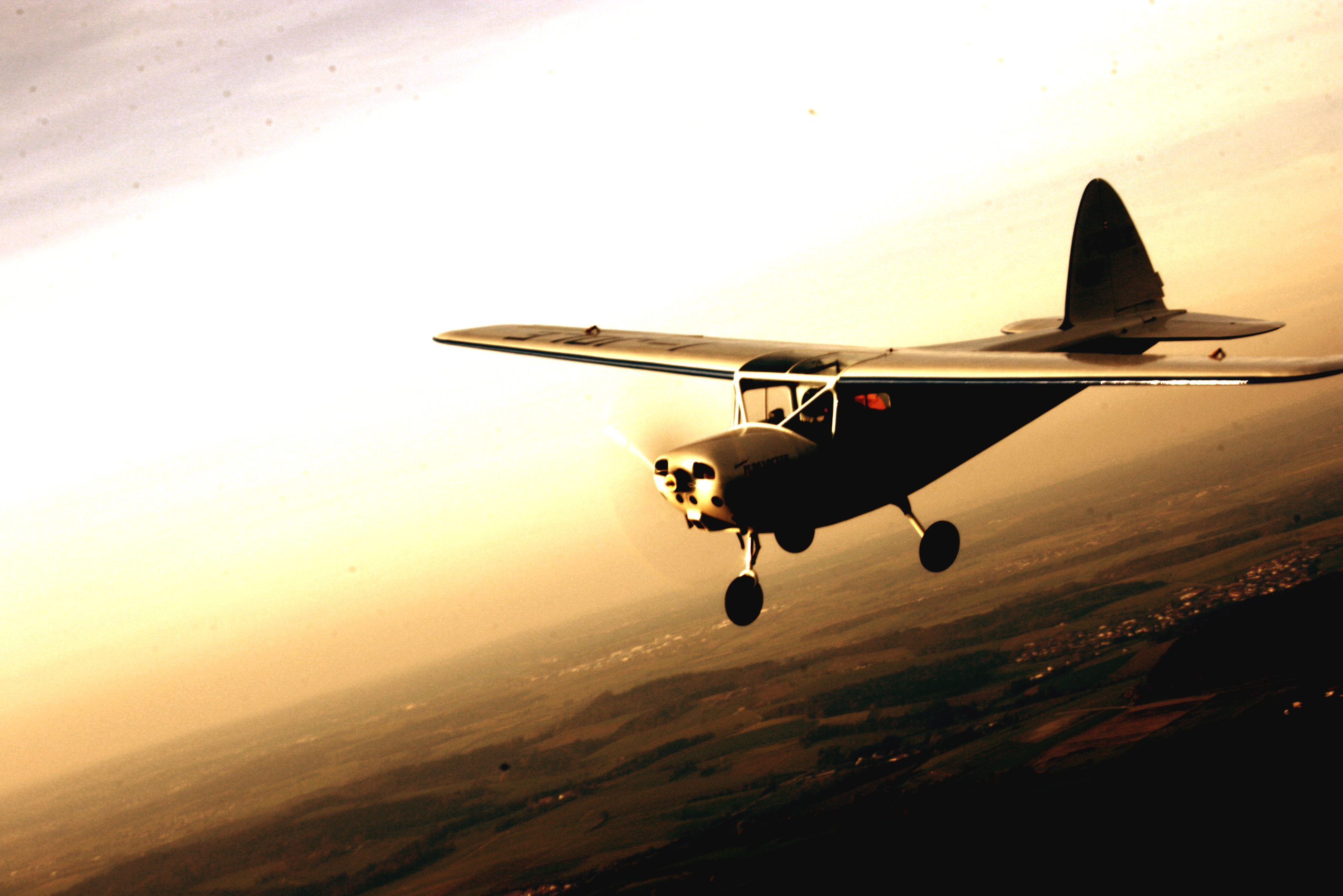 Sunset reflections.Our MB 308 flying over the Donau valley